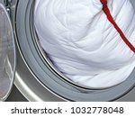 pillow in the washing machine....   Shutterstock . vector #1032778048