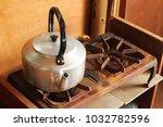 An Old Aluminum Tea Kettle On A ...