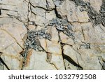 Small photo of Natural rocky inhomogeneous background of shale stones of different sizes.