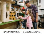 father and daughter buying... | Shutterstock . vector #1032806548