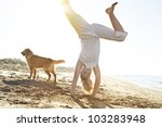 Girl With Dog On The Beach ...