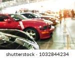 modern sport cars in a showroom ...   Shutterstock . vector #1032844234