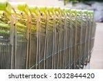 Row of empty shopping carts.
