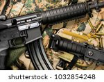 automatic rifle lying on a... | Shutterstock . vector #1032854248