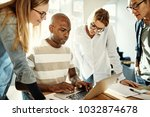 diverse group of focused young... | Shutterstock . vector #1032874678
