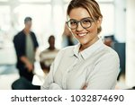 confident young businesswoman... | Shutterstock . vector #1032874690