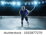 hockey player in ice arena | Shutterstock . vector #1032877270