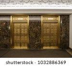 two golden elevators in classic ...