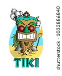 a tiki totem on the beach with... | Shutterstock .eps vector #1032886840