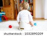 closeup of legs of cute little... | Shutterstock . vector #1032890209