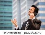 happy businessman in suit and... | Shutterstock . vector #1032902140