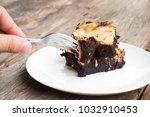closeup woman using fork pick... | Shutterstock . vector #1032910453