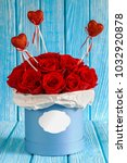 red roses flowers in a blue box ...   Shutterstock . vector #1032920878