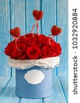 red roses flowers in a blue box ...   Shutterstock . vector #1032920884