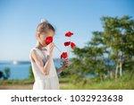 slim cute little girl sniffing... | Shutterstock . vector #1032923638