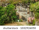 """Small photo of Tana Toraja, Sulawesi, Indonesia - oct 2009 : At the village Lemo, near Rantepao, the spectacular wall with rock tombs and dozens of """"tau tau"""", representing the deceased"""