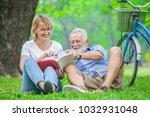 happy elderly couple with...   Shutterstock . vector #1032931048