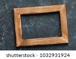 classic wooden frame on dark...   Shutterstock . vector #1032931924