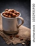 full mug of hazelnuts with peel ...   Shutterstock . vector #1032931930