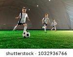 three boys in uniform running... | Shutterstock . vector #1032936766