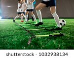row of little football players... | Shutterstock . vector #1032938134