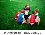 young trainer showing his... | Shutterstock . vector #1032938173