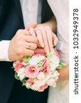 the hand of the bridegroom... | Shutterstock . vector #1032949378