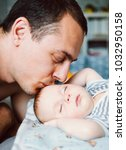 happy young father looking with ... | Shutterstock . vector #1032950158
