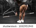 Muscular Woman In Gym Training...