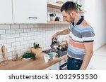 man preparing coffee. pouring... | Shutterstock . vector #1032953530