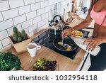 fitness woman prepare omlette... | Shutterstock . vector #1032954118