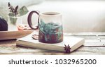 book and a cup of tea on a... | Shutterstock . vector #1032965200