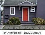 dark house with a red door | Shutterstock . vector #1032965806