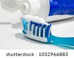 toothbrush with paste | Shutterstock . vector #1032966883