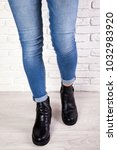 female shoes on legs in jeans... | Shutterstock . vector #1032983920