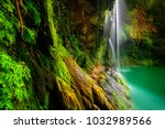 amazing waterfalls among... | Shutterstock . vector #1032989566