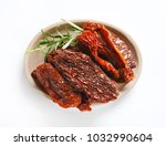 plate of sun dried tomatoes... | Shutterstock . vector #1032990604