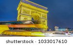 traffic around triumph arc at... | Shutterstock . vector #1033017610