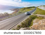 car in mountains of norway ... | Shutterstock . vector #1033017850