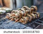 grilled mushrooms on skewers... | Shutterstock . vector #1033018783