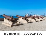 old cannons. stone town ... | Shutterstock . vector #1033024690