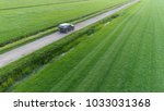 aerial photo of unpaved road...   Shutterstock . vector #1033031368