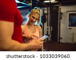fitness instructor showing... | Shutterstock . vector #1033039060