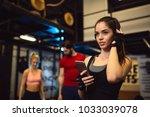 portrait of young sportswoman...   Shutterstock . vector #1033039078