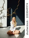 beautiful blond girl in a white ... | Shutterstock . vector #1033049974