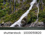 scenery at milford sound  south ... | Shutterstock . vector #1033050820