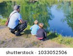 dad and children are fishing.... | Shutterstock . vector #1033052506
