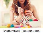attractive woman painting... | Shutterstock . vector #1033053586