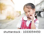 cute asian little girl in... | Shutterstock . vector #1033054450