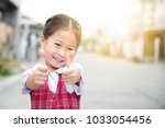 cute asian little girl in... | Shutterstock . vector #1033054456